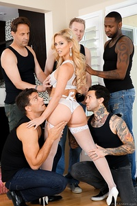 With her stunning face and curves, blonde MILF Cherie DeVille merits a manhandling, five-cock gang bang! The playful beauty shows off big boobs and a round, winking butt in a luxurious, 12-minute poolside striptease. Inside, Ramon Nomar lifts her bodily for a carry-fuck that makes giddy Cherie's long hair fly. He nails her ass acrobatically. Eric John chokes her as he plows her pussy and butthole to orgasm. Cherie blushes in climax from massively hung Jon Jon's interracial drilling. Tattooed Small Hands stuffs her holes, Cherie masturbating. Director Mark Wood fucks her mouth and cunt. Five erections encircle Cherie in a slobbery, gagging blow bang. The dudes trade off double-penetrating the dirty-talking dervish till her butthole gapes. Five studs blow thick wads of semen all over Cherie's trashed makeup; a river of cum flows to her bald gash. Marathon scene runs 78 minutes!